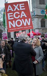 © Licensed to London News Pictures. 13/03/2017. London, UK.  A woman argues with a Pro-Leave campainger as protestors gather in Parliament Square to defend EU migrants' right to remain in the UK after Brexit.  Parliament is expected to pass the Brexit bill this week allowing the Prime Minister to trigger Article 50. Photo credit: Peter Macdiarmid/LNP