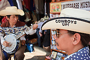"""Mar. 8, 2009 -- BANGKOK, THAILAND:  The """"Blue Mountain Boys,"""" a Thai bluegrass duo perform and sell CDs in the Chatuchak Weekend Market. The market covers an area of 35 acres with more than 15,000 shops and stalls. It has over 200,000 visitors each day it's open (Friday - Sunday), and they spend an estimated total of 30 million baht (approx US$750,000). The range of products on sale is extensive, and includes household accessories, handicrafts, religious artifacts, art, antiques, live animals (which unfortunately are frequently caged in cruel conditions), books, music, clothes, food, plants and flowers. Photo by Jack Kurtz / ZUMA Press"""