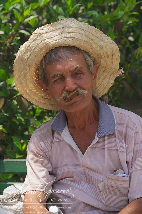 A cuban man smoking cigar. Ceinfuegos, Cuba.