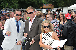 Left to right, JAMES PUREFOY, RUPERT PENRY-JONES and GEORGIE THOMPSON at a luncheon hosted by Cartier for their sponsorship of the Style et Luxe part of the Goodwood Festival of Speed at Goodwood House, West Sussex on 1st July 2012.