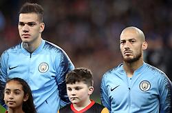 Manchester City goalkeeper Ederson (left) and David Silva
