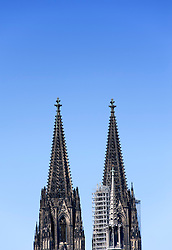 View of spires of famous Cathedral or Dom in Cologne Germany
