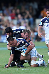Chris Lowrey of The Blues is caught by Jannie du Plessis during the Super15 match between The Mr Price Sharks and The Blues held at Mr Price Kings Park Stadium in Durban on the 26th February 2011..Photo By:  Ron Gaunt/SPORTZPICS