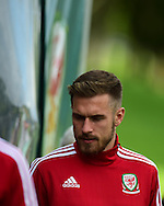 Aaron Ramsey of Wales looks on during the Wales football team training session at the Vale Resort, Hensol Castle near Cardiff ,South Wales on Monday 31st August  2015. The team are preparing for their next EURO 2016 qualifying match away to Cyprus later this week.<br /> pic by Andrew Orchard, Andrew Orchard sports photography.