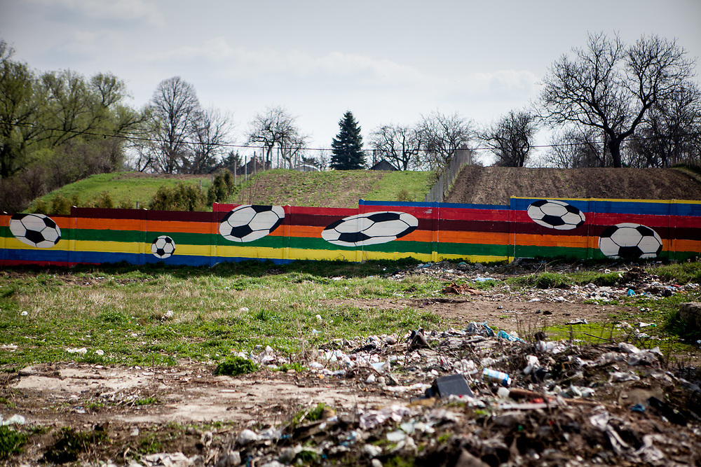 The wall at the Roma settlement in Ostrovany seen from the side of the settlement.