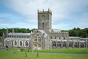 Clergymen leaving St David's Cathedral founded as 6th Century monastery, St David's Pembrokeshire, West Wales.