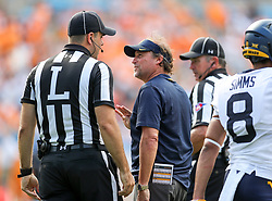 Sep 1, 2018; Charlotte, NC, USA; West Virginia Mountaineers head coach Dana Holgorsen questions a referee during the second quarter against the Tennessee Volunteers at Bank of America Stadium. Mandatory Credit: Ben Queen-USA TODAY Sports