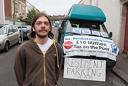© Licensed to London News Pictures. 17/06/2015. Bristol, UK.  Alex Taylor, age 33 who claims he was assaulted by a contractor working on the RPZ scheme in Montpelier, Bristol, last Monday  The matter is now in the hands of the police.  Protest in Montpelier, Bristol, against the new Residents Parking Zone (RPZ) as road markings are painted for parking bays and double yellow lines.  Some residents from Montpelier have blockaded East Gove and are refusing to allow contractors to paint RPZ road markings.  Photo credit : Simon Chapman/LNP