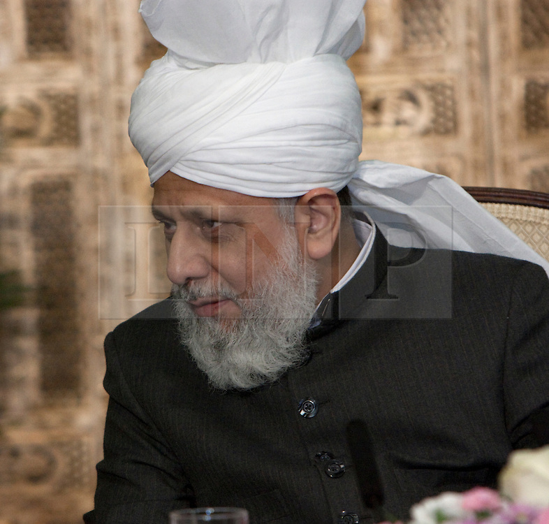 © Licensed to London News Pictures. 24/03/2012. Surrey, U.K..Hadhrat Mirza Masroor Ahmad at Europe's largerst mosque, Baitul Futuh Mosque, in Morden, Surrey, which holds 10,000 worshipers. .Parliamentarians and religious, civic, charitable and community leaders meet here this evening 24/3/2012 for a National Peace Symposium on International Peace organised by the Ahmadiyya Muslim community to hear how Muslims are countering extremism..Photo credit : Rich Bowen/LNP