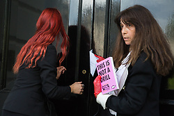 London, UK. 2 July, 2019. Climate change activists from Extinction Rebellion Art and Culture attempt to deliver a letter and booklet to the offices of Repsol S.A. during a silent procession visiting the offices of five major oil companies - ENI, CNPC, Saudi Aramco, Repsol and BP - to declare them a crime scene.