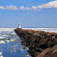 """""""Presque Isle Harbor Light""""<br /> <br /> Beautiful rock jetty and lighthouse in Presque Isle Harbor with ice formations floating all around. A stunning setting in Marquette Michigan!"""