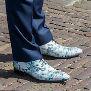 NLD/Den Haag/20180831 - Koninklijke Willems orde voor vlieger Roy de Ruiter,opvallende schoenen van minister Hugo de Jonge