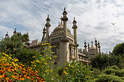 The Royal Pavilion and gardens on the 19th July 2018 in Brighton in the United Kingdom. The Royal Pavilion, also known as the Brighton Pavilion, is a Grade I listed former royal residence located in Brighton, England.