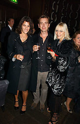 Left to right, TRACEY EMIN, SCOTT DOUGLAS and VIRGINIA BATES at a party hosted by Dom Perignon at Sketch, Conduit Street, London on 18th October 2006.<br />