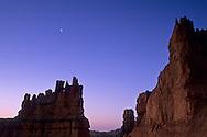 Crescent moon at dawn over Hoodoos Navajo Loop Trail, Bryce Canyon National Park, UTAH