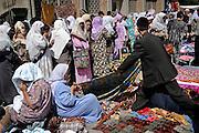 Namangan, Uzbekistan, 14/05/2004..Street market outside the city's largest mosque before Friday prayers.