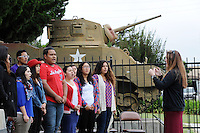 The Salinas High School A Cappella Ensemble sing the national anthem at the annual Avenue of Flags Memorial Day Program at Garden of Memories Memorial Park in Salinas.