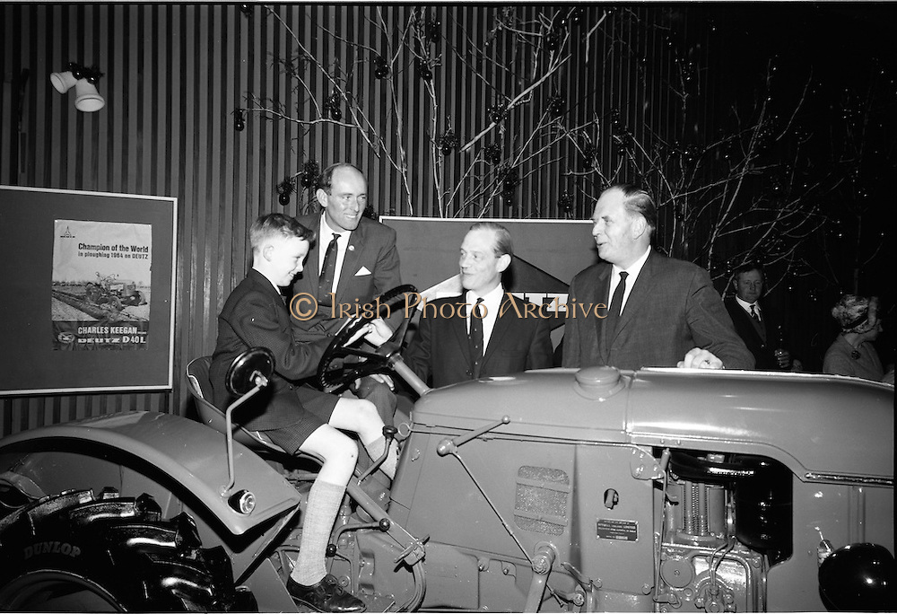 15/12/1964.12/15/1964.15 December 1964.Deutz tractor presented to Alan Keegan at the Intercontinental Dublin. Ten year old Alan Keegan tries out his ew tractor for size, with L-R: his father Charles Keegan, Mr J.C. McNeill, Chairman McNeill Group and Mr. R.J. Walby Managing Director McNeill Ltd. Charles Keegan was the 1964 Ploughing World Champion.