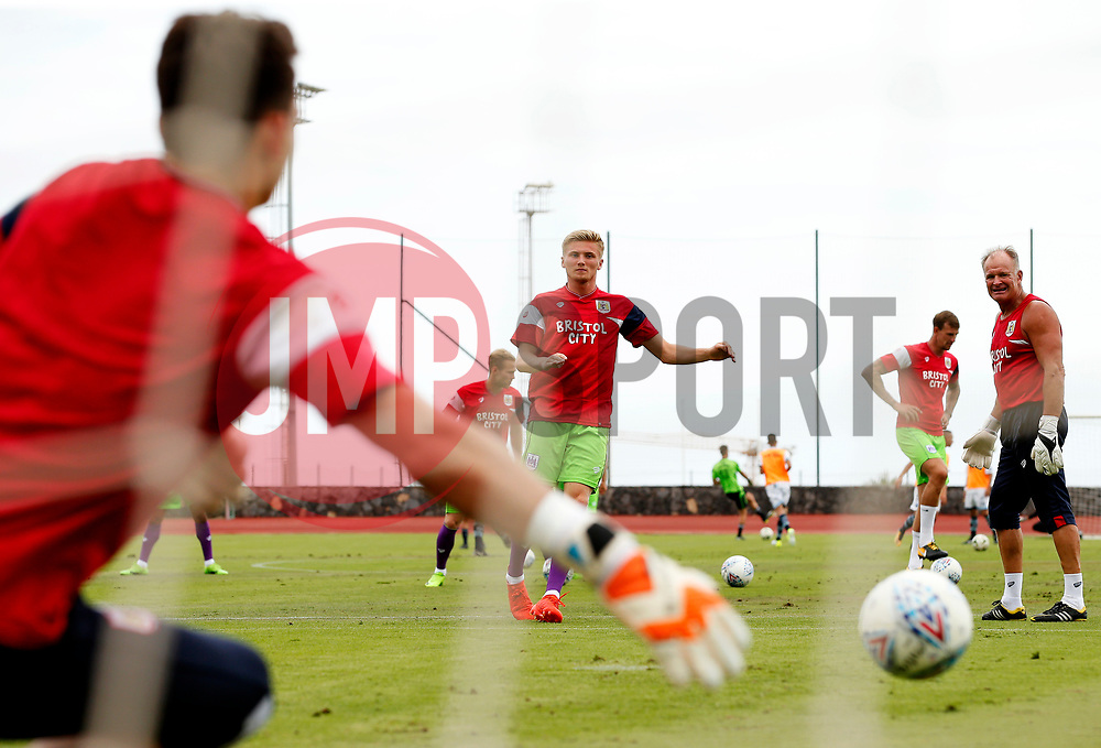 Max O'Leary of Bristol City saves a shot from Taylor Moore during the warm up - Mandatory by-line: Matt McNulty/JMP - 22/07/2017 - FOOTBALL - Tenerife Top Training - Costa Adeje, Tenerife - Bristol City v Atletico Union Guimar  - Pre-Season Friendly