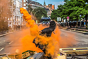 A protestor is throwing an orange smoke granade towards the police, during clashes in Hamburg, On July 7,2017.<br /> On the second day of the anti G20 demonstrations clashes were reported in some parts of the city between protesters and police. Big chain department stores and cars were damaged by some anti capitalist groups.