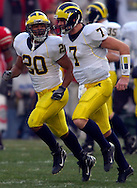 MORNING JOURNAL/DAVID RICHARD&#xA;Mike Hart, left, put the Wolverines on the board first after a handoff by Chad Henne.<br />