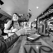 Heather Goodrich and Courtney Gauthier have a drink after mountain biking Teton Pass at the Stagecoach Bar.