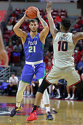 NORMAL, IL - November 06:  Brady Ernst looks to pass off when encountering Phil Fayne during a college basketball game between the ISU Redbirds  and the Florida Gulf Coast Eagles on November 06 2018 at Redbird Arena in Normal, IL. (Photo by Alan Look)