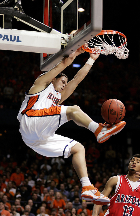 Basketball, NCAA Chicago Regional Final..Illinois' Deron Williams (5) slam dunks iin front of Arizona's Chris Rodgers (13) n the first half as University of Illinois plays University of Arizona in the NCAA Midwest Regional Championship game at the Allstate Arena in Rosemont, Illinois.