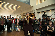 Trombonist Martha Ann Brookes from the Birmingham Opera Company performs Hi Sam inside The Mailbox to an audience, during the Birmingham Weekender Arts And Culture Festival on 23rd September 2017 in Birmingham, United Kingdom.