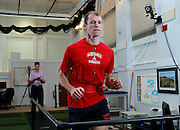 Matt Clay runs on a tread mill wearing reflective balls allowing several infrared emitting cameras to capture a 3D image of the his movements which are then analyzed at the UVA SPEED Clinic in Charlottesville, VA. Photo/Andrew Shurtleff