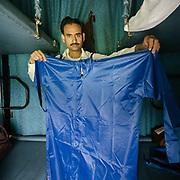 Peddler selling rain jacket.<br /> Life on the longest train ride in India, between Kanyakumari and Dibrugarh city.