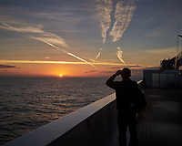 Jet Contrails at Sunrise over the North Atlantic Ocean from the Deck of MV Explorer. Image taken with a Leica X2 camera (ISO 100, 24 mm, f/5.6, 1/250 sec).