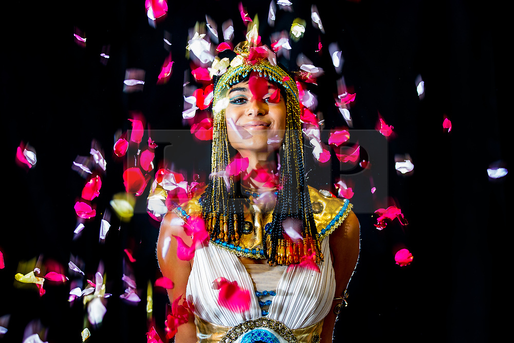 © Licensed to London News Pictures. 13/09/2018. Harrogate UK. Jeshika Mullins dressed as queen Cleopatra at the Harrogate Flower show which starts tomorrow in Harrogate. The theme of this years show is the sweet scent of love, Egyptian Queen Cleopatra is said to have overwhelmed her roman admirers, Julius Caesar & Mark Antony with a love elixir made of rose petals. Photo credit: Andrew McCaren/LNP