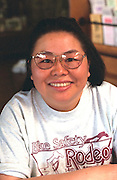 Asian volunteer age 33 at the Youth Express Bicycle Safety Rodeo.  St Paul Minnesota USA