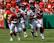 Running back Michael Pittman $28 of the Denver Broncos rushes past the Kansas City Chiefs defense for 40-yards in the second quarter at Arrowhead Stadium in Kansas City, Missouri on September 28, 2008.. ..