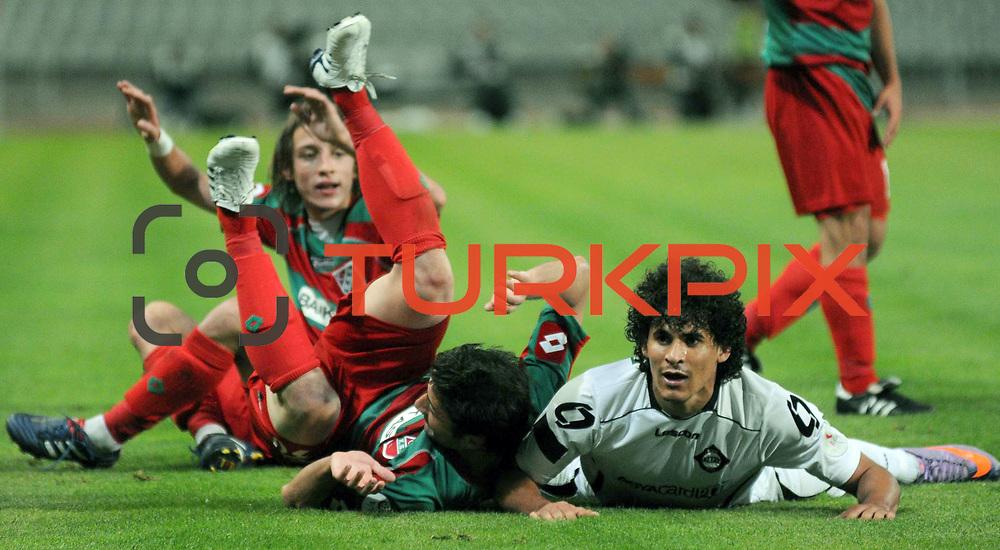 Altayspor's Tiago Queiroz BEZERRA (R) during their Play Off First leg match at Ataturk olympic Stadium in Istanbul Turkey on Monday, 17 May 2010. Photo by TURKPIX