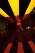 A woman walks through a hallway at The Cosmopolitan of Las Vegas.