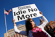 "Sadie Smith, 9, holds a sign that reads ""Texicana Idle No More"" during an Idle No More, a Native American movement group, sing songs and perform a Circle Dance to create awareness about Native American issues in Canada at Dealey Plaza Park in Dallas, Texas, on January 6, 2013.  (Stan Olszewski/The Dallas Morning News)"