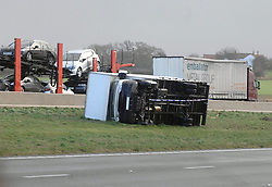 Licensed to London News Pictures 05/12/2013 A lorry blown over by high winds in central reservation of A1 between J49 and J50 near Ripon, N Yorks. Photo Credit: Sam Atkins/LNP