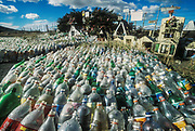 Soft drink bottle form memorial at road side grave after car accident, Puero Natales, Patagonia, Chile.