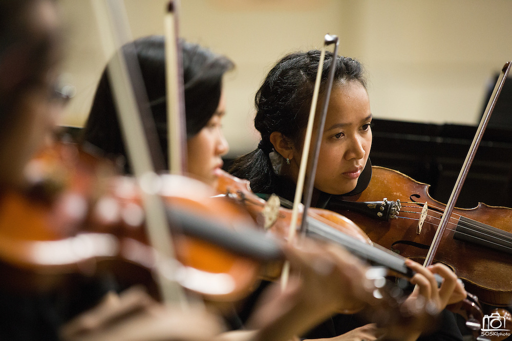 Jubilee Hardwick, senior, of Milpitas High School plays the viola during the Milpitas Unified School District's Tenth Annual Music Festival at Milpitas High School in Milpitas, California, on April 4, 2013. (Stan Olszewski/SOSKIphoto)
