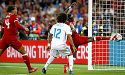 (L-R) Virgil van Dijk of Liverpool FC, Marcelo of Real Madrid CF, Sadio Mane of Liverpool FC scoring 1-1 during the UEFA Champions League final between Real Madrid and Liverpool on May 26, 2018 at NSC Olimpiyskiy Stadium in Kyiv, Ukraine