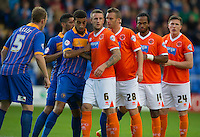 Blackpool's Peter Clarke, Jeffrey Rentmeister, Jeffrey Rentmeister, Nathan Delfouneso and John Lundstram jostle for position ready for a corner kick<br /> <br /> Photo by Stephen White/CameraSport<br /> <br /> Football - Capital One Cup First Round - Shrewsbury Town v Blackpool - Tuesday 12th August 2014 - Greenhous Meadow - Shrewsbury<br />  <br /> © CameraSport - 43 Linden Ave. Countesthorpe. Leicester. England. LE8 5PG - Tel: +44 (0) 116 277 4147 - admin@camerasport.com - www.camerasport.com