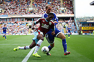 Tendayi Darikwa of Burnley and Philipp Hofmann of Brentford tussle for the ball. Skybet football league championship match, Burnley  v Brentford at Turf Moor in Burnley, Lancs on Saturday 22nd August 2015.<br /> pic by Chris Stading, Andrew Orchard sports photography.