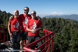 Michael Lichter (L), Sean Lichter and Jonathan Pite on the patio of our inn near the village of Daman where we spent our first night in the mountains after day-1 of our Himalayan Heroes adventure riding from Kathmandu to Daman, Nepal. The view took in from Dhaulagiri in the west to Mount Everest in the east. Tuesday, November 6, 2018. Photography ©2018 Michael Lichter.