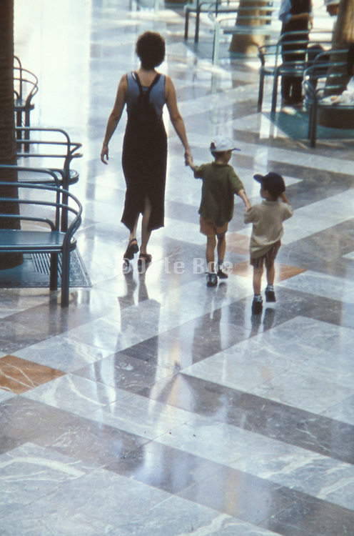 a mother walking with her two sons.