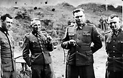 Dr Josef Mengele (1911-1979) left, known as 'The Angel of Death' for the medical experiments he carried out on the inmates of Auschwitz, the German Nazi concentration. Next to him is Rudolf Höss, Commandant of Auschwitz; Second from right is Josef Kramer, Commandant of Belsen; Right, an unidentified German officer.
