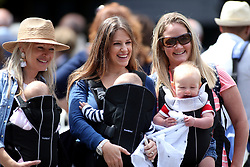 Spectators with babies on day nine of the Wimbledon Championships at The All England Lawn Tennis and Croquet Club, Wimbledon.