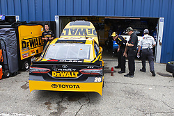 June 10, 2018 - Brooklyn, Michigan, U.S - The crew of the DeWalt Toyota works on the car driven by ERIK JONES (20) at Michigan International Speedway. (Credit Image: © Scott Mapes via ZUMA Wire)
