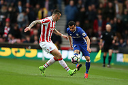 Pedro of Chelsea looks to go past Geoff Cameron of Stoke city.Premier league match, Stoke City v Chelsea at the Bet365 Stadium in Stoke on Trent, Staffs on Saturday 18th March 2017.<br /> pic by Andrew Orchard, Andrew Orchard sports photography.